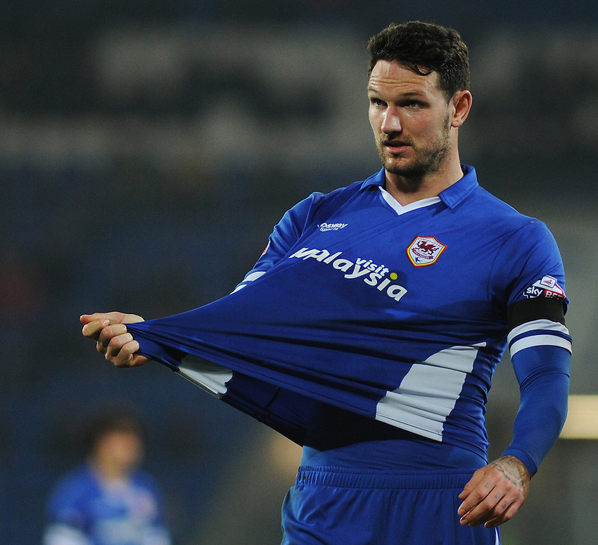 Cardiff City's Sean Morrison illustrates shirt pulling to the referee<br /> <br /> Photographer Kevin Barnes/CameraSport<br /> <br /> Football - The Football League Sky Bet Championship - Cardiff v Bournemouth - Tuesday 17th March 2015 - Cardiff City Stadium - Cardiff<br /> <br /> &copy; CameraSport - 43 Linden Ave. Countesthorpe. Leicester. England. LE8 5PG - Tel: +44 (0) 116 277 4147 - admin@camerasport.com - www.camerasport.com