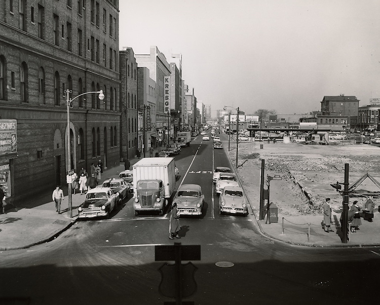 "1956 February 01..Redevelopment.Downtown North (R-8)..View looking North up Monticello Avenue from City Hall Avenue.Site of Maritime Office Building..""This photograph shows the Maritime Tower site in downtown Norfolk after its preparation to receive the new building - another step toward urban renewal.""..PHOTO CRAFTSMEN INC..NEG# 27-550.NRHA#699.."