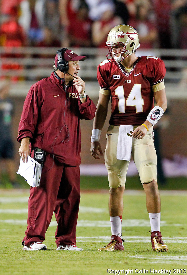 TALLAHASSEE, FLA 9/21/13-FSU-BCC092113CH-Florida State Head Coach Jimbo Fisher, left, talks with Jacob Coker during a second half break against Bethune Cookman Saturday at Doak Campbell Stadium in Tallahassee. The Seminoles beat the Wildcats 54-6.<br /> COLIN HACKLEY PHOTO