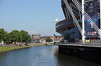 Pictured: A man in a boat sails past the National Stadium of Wales (aka Principality Stadium) in river Taff Thursday 25 May 2017<br />