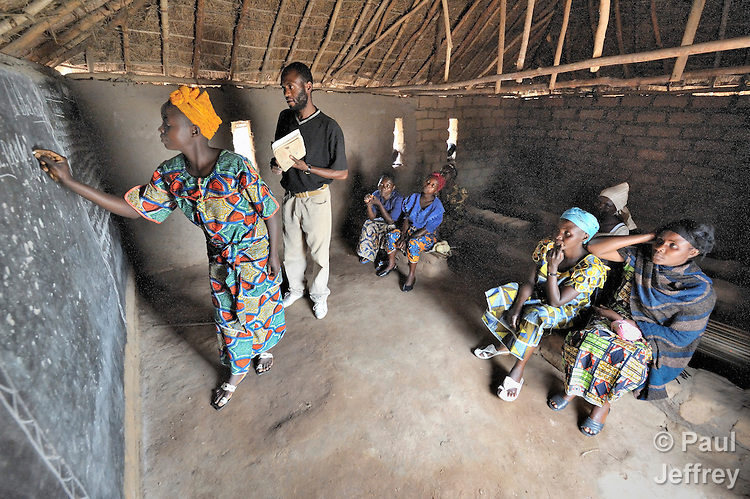 Women in Mwitobwe, a village in the Democratic Republic of the Congo, learn basic literacy skills in a workshop supported by United Methodist Women. The program involves both skills training and literacy classes.
