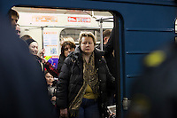 Moscow, Russia, 30/03/2010..A passenger stares from a Moscow Metro carriage as extra police stand guard inside Park Kultury metro station where a female suicide bomber blew herself up the previous day. At least 39 people were killed and 80 injured in the double blasts at Moscow metro stations during the morning rush hour.