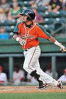 Second baseman Rony Cabrera (2) of the Greensboro Grasshoppers bats in a game against the Greenville Drive on Thursday, August 27, 2015, at Fluor Field at the West End in Greenville, South Carolina. Greenville won, 10-2.  (Tom Priddy/Four Seam Images)