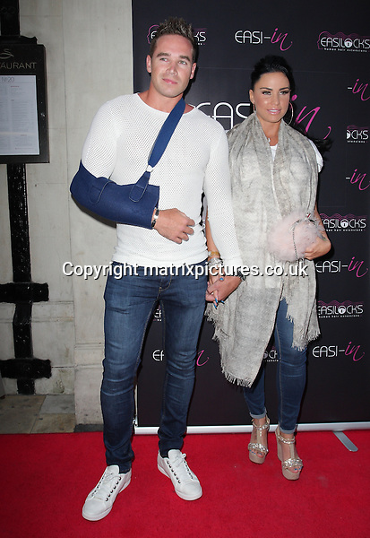 NON EXCLUSIVE PICTURE: MATRIXPICTURES.CO.UK<br /> PLEASE CREDIT ALL USES<br /> <br /> WORLD RIGHTS<br /> <br /> Pregnant English media personality Katie Price and husband Kieran Hayler attending the Easilocks launch party at London's Sanctum Hotel.<br /> <br /> JULY 9th 2013<br /> <br /> REF: GBH 134704