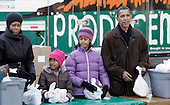 Chicago, IL - November 26, 2008 -- United States President-elect Barack Obama, right, with wife Michelle, left and daughters Sasha (2nd L) and Malia, pass out food at St. Columbanus Parrish and School Wednesday, November 26, 2008, in Chicago, Illinois. .Credit: Frank Polich - Pool via CNP
