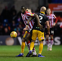 Lincoln City's John Akinde vies for possession with Newport County's David Pipe<br /> <br /> Photographer Chris Vaughan/CameraSport<br /> <br /> The EFL Sky Bet League Two - Lincoln City v Newport County - Saturday 22nd December 201 - Sincil Bank - Lincoln<br /> <br /> World Copyright &copy; 2018 CameraSport. All rights reserved. 43 Linden Ave. Countesthorpe. Leicester. England. LE8 5PG - Tel: +44 (0) 116 277 4147 - admin@camerasport.com - www.camerasport.com
