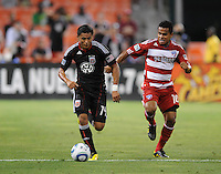 DC United midfielder Andy Najar (14) runs with the ball follow by FC Dallas forward David Ferreira (10).  FC. Dallas defeated DC United 3-1 at RFK Stadium, Saturday August 14, 2010.