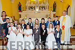 Children from Kilmoyley NS with their teacher Angela O'Carroll and PP Fr Tadhg Fitzgerald after their First Holy Communion in Kilmoyley Church, on Saturday.