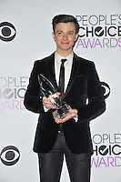 Chris Colfer in the pressroom at the 2014 People's Choice Awards at the Nokia Theatre, LA Live.<br /> January 8, 2014  Los Angeles, CA<br /> Picture: Paul Smith / Featureflash