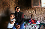 Portrait of a Bedouin woman and her daughter in Petra, Jordan. Petra is the most visited tourist attraction in Jordan, a symbol of the country for its historical and archaeological importance. It has been a UNESCO World Heritage Site since 1985. The Bedouin families that have been living for centuries in the caves of Petra, agreed to move out into a small village, built near the site of Petra. Most of them earn their living from tourism which seems to be the only option available, especially for the younger generations.