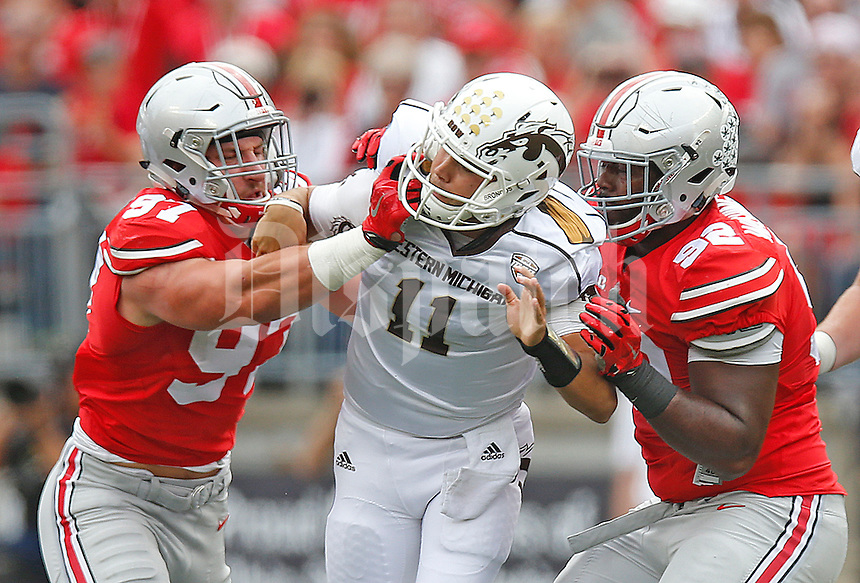 Ohio State Buckeyes defensive lineman Joey Bosa (97) and Ohio State Buckeyes defensive lineman Adolphus Washington (92) pressure Western Michigan Broncos quarterback Zach Terrell (11) in first quarer play at Ohio Stadium on September 26, 2015. (Chris Russell/Dispatch Photo)