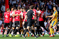 Brentford players surround Wigan's Sam Morsy after a challenge on Brentford's Yoann Barbet during Brentford vs Wigan Athletic, Sky Bet EFL Championship Football at Griffin Park on 15th September 2018