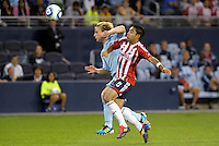Marco Fabian (8) Chivas Gudalajara challenges for the ball with Seth Sinovic (16) Sporting KC... Sporting Kansas City and Chivas Guadalajara played to a 2-2 tie in an international friendly at LIVESTRONG Sporting Park, Kansas City, Kansas.