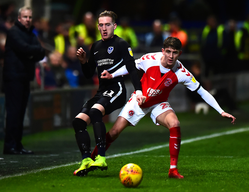 Portsmouth's Ronan Curtis battles with Fleetwood Town's Harrison Biggins<br /> <br /> Photographer Richard Martin-Roberts/CameraSport<br /> <br /> The EFL Sky Bet League One - Fleetwood Town v Portsmouth - Saturday 29th December 2018 - Highbury Stadium - Fleetwood<br /> <br /> World Copyright © 2018 CameraSport. All rights reserved. 43 Linden Ave. Countesthorpe. Leicester. England. LE8 5PG - Tel: +44 (0) 116 277 4147 - admin@camerasport.com - www.camerasport.com