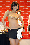 """Lingerie maker Triumph's campaign girl Hiromi Nishiuchi, 19, wears the """"Jury System Bra"""" which was created for the company's 2009 spring/summer collection held at Tokyo Ryutsu Center. Triumph International Japan, which annually creates a unique bra to reflect a current social issue, expects the Jury System Bra to raise public awareness of the lay juror system, which will start in Japan from May 21, 2009."""