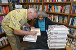"""CORAL GABLES, FL - MAY 17: Author Les Standiford signing a copy of his book to Former """"Angola 3"""" inmate Albert Woodfox after Albert book signing of """"Solitary"""" at Books & Books on May 17, 2019 in Coral Gables, Florida. ( Photo by Johnny Louis / jlnphotography.com )"""