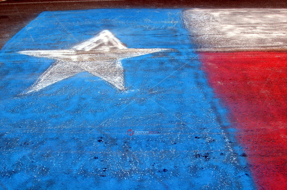 Texas Lone Star Flag painted in chalk in Austin, Texas, USA