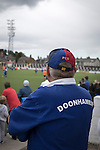 Queen of the South 2 Stranraer 0, 11/08/2015. Scottish Challenge Cup first round, Palmerston Park. A man in the home end watching the action during the first-half at Palmerston Park, Dumfries, as Queen of the South (in blue) host Stranraer in a Scottish Challenge Cup first round match. The game was the opening match of the season in a competition open to sides below the Scottish Premiership. Queen of the South won the match 2-0, watched by a crowd of 1229 spectators. Photo by Colin McPherson.