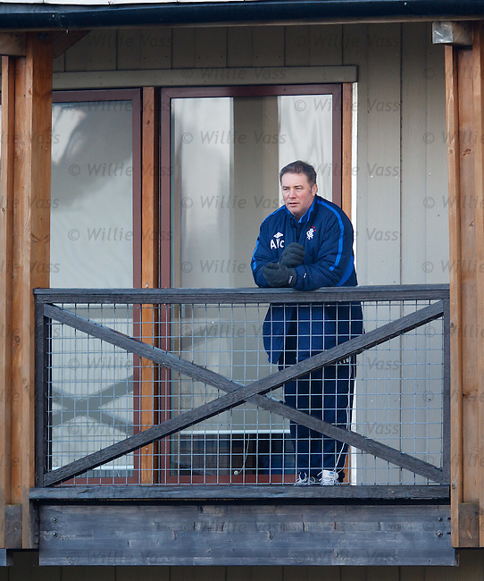 Ally McCoist climbs up to watch a practice match at training from the balcony outside his office