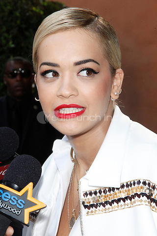 LOS ANGELES, CA - JANUARY 25: Rita Ora at the Roc Nation Pre-Grammy brunch presented by MAC Viva Glam at a private residency on January 25, 2014 in Los Angeles, California. Credit: Star Shooter/MediaPunch