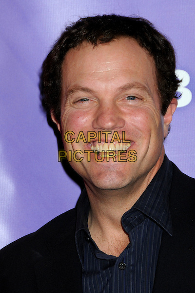 ADAM BALDWIN .NBC Universal Press Tour Cocktail Party held at the Langham Hotel, Pasadena, California, USA, 10th January 2010..portrait headshot black blue smiling teeth .CAP/ADM/BP.©Byron Purvis/AdMedia/Capital Pictures.