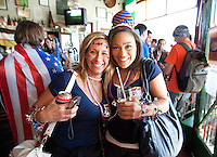 USA fans Denise Martorana (left) and Vanessa Johnson (right) of New York City hang out at the Radium Beer Hall before going to  Ellis Park Stadium for the  2010 World Cup match between the USA and Slovenia in Johannesburg, South Africa on Friday, June 18, 2010.  The USA tied Slovenia 2-2.