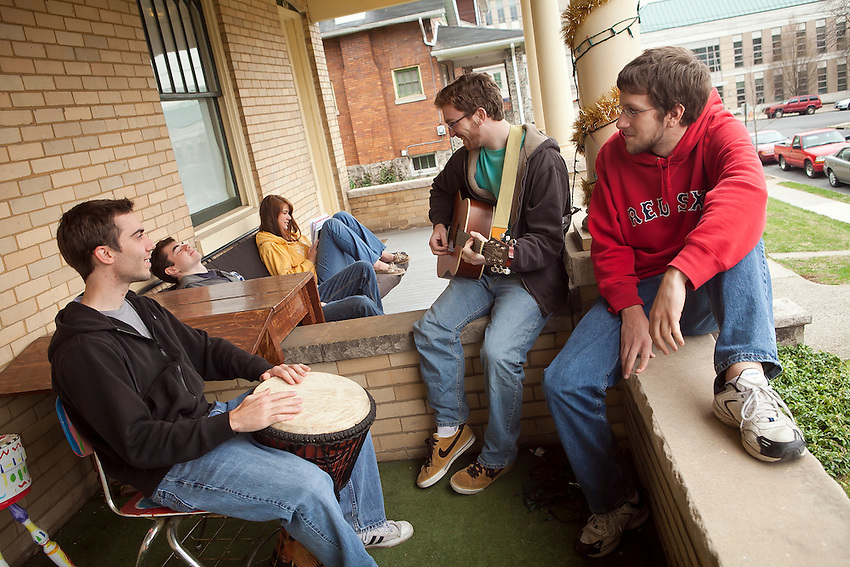 Students interesting in the Arts have the option of off campus housing in Art Houses on Parsons Street near the campus. Students are seen in their houses.  Here clockwise from left at 624 Parsons are seniors Ben Boyer, Peter Mara, Melanie Defazio, Andy Feldman, and Mike Follett