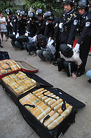 Police show 82 kilograms of amphetamines that in Jinghong, China. The drugs with a street value of at least 40 million RMB (about 6 million US$) were smuggled from Burma. Chinese-Burmese gangs smuggle drugs across the border and smuggle them out using drug mules....PHOTO BY SINOPIX