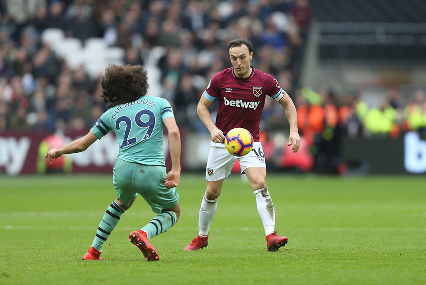 West Ham United's Mark Noble and Arsenal's Matteo Guendouzi<br /> <br /> Photographer Rob Newell/CameraSport<br /> <br /> The Premier League - West Ham United v Arsenal - Saturday 12th January 2019 - London Stadium - London<br /> <br /> World Copyright © 2019 CameraSport. All rights reserved. 43 Linden Ave. Countesthorpe. Leicester. England. LE8 5PG - Tel: +44 (0) 116 277 4147 - admin@camerasport.com - www.camerasport.com