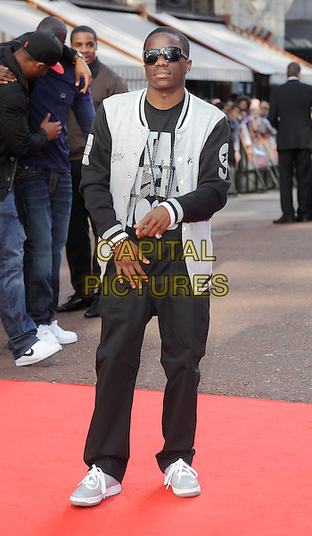 "TINCHY STRYDER (Kwasi Danquah).The Gala Premiere of ""The Karate Kid"", Odeon Leicester Square, London, England, UK..15th July 2010.full length black sunglasses shades white slogan sleeve jacket hands  baseball jersey grey gray jacket jeans denim.CAP/BEL.©Tom Belcher/Capital Pictures."