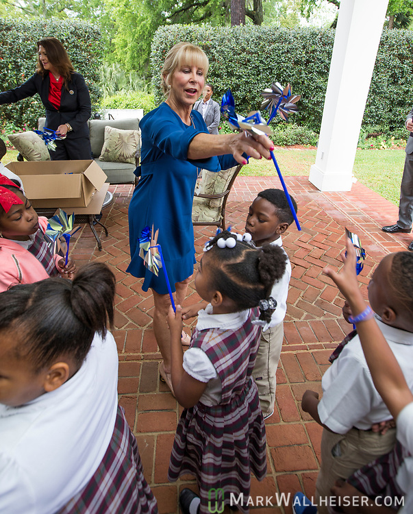 "First Lady Ann Scott hands out pinwheels after a press conference to launch Prevent Child Abuse with Florida's annual ""Pinwheels for Prevention"" campaign at the Florida Governor's Mansion."
