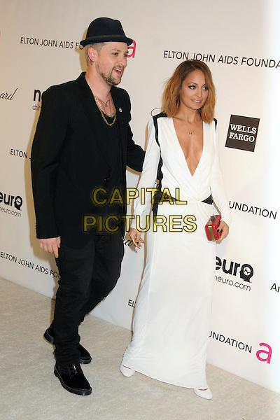Joel Madden and Nicole Richie Madden.21st Annual Elton John Academy Awards Viewing Party held at West Hollywood Park, West Hollywood, California, USA..February 24th, 2013.oscars full length  black suit hat beard facial hair white dress long sleeves plunging neckline cleavage red clutch bag married husband wife.CAP/ADM/BP.©Byron Purvis/AdMedia/Capital Pictures.