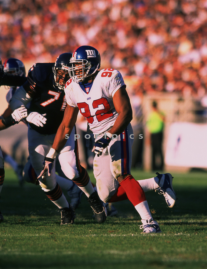 New York Giants, Michael Strahan (92) during a game against the Chicago Bears on September 17, 2000 at Soldier Field in Chicago, Illinois. The Giants beat the Bears 14-7. Michael Strahan played for 15 years all with the Giants. He was a 7-time Pro Bowler and was inducted to the Pro Football Hall of Fame in 2014.(SportPics)