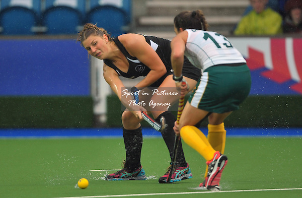 Olivia Merry (NZL) passes past Lisa-marie Deetlefs (RSA). South Africa (RSA) v New Zealand (NZL). Womens bronze medal match. Hockey. PHOTO: Mandatory by-line: Garry Bowden/SIPPA/Pinnacle - Tel: +44(0)1363 881025 - Mobile:0797 1270 681 - VAT Reg No: 183700120 - 020814 - Glasgow 2014 Commonwealth Games - Glasgow national hockey centre, Glasgow, Scotland, UK