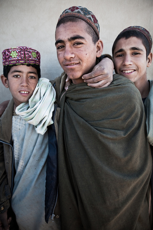 Afghan workers photographed at Combat Outpost JFM in Zhari District, Kandahar, Afghanistan. 2010.