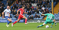 Milton Keynes Dons' Osman Sow scores the opening goal as he slots pass Bury's Leonardo Fasan <br /> <br /> Photographer Juel Miah/CameraSport<br /> <br /> The EFL Sky Bet League One - Bury v Milton Keynes Dons - Saturday 30th September 2017 - Gigg Lane - Bury<br /> <br /> World Copyright &copy; 2017 CameraSport. All rights reserved. 43 Linden Ave. Countesthorpe. Leicester. England. LE8 5PG - Tel: +44 (0) 116 277 4147 - admin@camerasport.com - www.camerasport.com