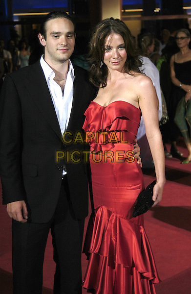 "LYNN COLLINS.""The Merchant of Venice"" Premiere,.61st Venice Film Festival, Italy, .September 4th 2004..half length strapless long red satin ruffle dress.Ref: KP.www.capitalpictures.com.sales@capitalpictures.com.©Capital Pictures."