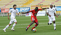 BOGOTA -COLOMBIA. 22-02-2014. John Sandoval (Izq) y Omar Rodriguez (Der)   de Fortaleza F.C. disputa el balon contra Carlos Renteria (centro) de Patriotas F.C. partido por la septima   fecha de La liga Postobon 1 disputado en el estadio Metropolitano de Techo . /   John Sandoval (L) and Omar Rodriguez (R) of Fortaleza F.C.  fights the ball  against Carlos Renteria of Patriotas F.C.  of  Seventh round during the match  of The Postobon one league  at the Metropolitano of Techo Stadium . Photo: VizzorImage/ Felipe Caicedo / Staff