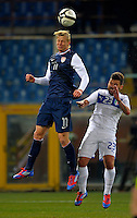 Brek Shea (l, USA) vs. Antonio Nocerino (r,USA), during the friendly match Italy against USA at the Stadium Luigi Ferraris at Genoa Italy on february the 29th, 2012.