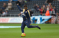 Alex Iwobi of Arsenal warms up before the Barclays Premier League match between Swansea City and Arsenal played at The Liberty Stadium, Swansea on October 31st 2015