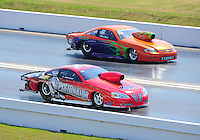 Apr. 29, 2011; Baytown, TX, USA: NHRA pro stock driver Steve Kent (near) races Dave River during qualifying for the Spring Nationals at Royal Purple Raceway. Mandatory Credit: Mark J. Rebilas-