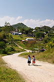 BELIZE, Punta Gorda, Toledo District, children in the Maya village of San Jose head home after school