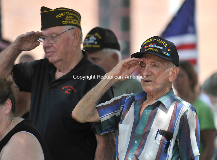 WATERBURY, CT-24 JULY 2010-072410IP08- John Buonocore (right) and Ed Karvelis, both Korean War veterans who grew up together in Waterbury, salute during the Waterbury Veterans Memorial Committee's thirteenth annual Korean War Veterans Remembrance Day Ceremony at the Waterbury Veterans Memorial in Waterbury on Saturday. The event recognized the cease-fire that ended three years of open warfare on the Korean Peninsula and honored local war veterans.<br /> Irena Pastorello Republican-American