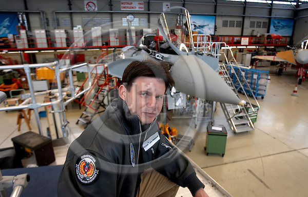 "MANCHING - GERMANY 12. DECEMBER 2006 -- Lars Illum Joergensen, flight test engineer with a Eurofighter, with which he has been flying, behind him, at his workplace EADS¥s aircraft construction and flight testing center where the Eurofighter is tested and assembled -- PHOTO: CHRISTIAN T. JOERGENSEN / EUP & IMAGES..This image is delivered according to terms set out in ""Terms - Prices & Terms"". (Please see www.eup-images.com for more details)"