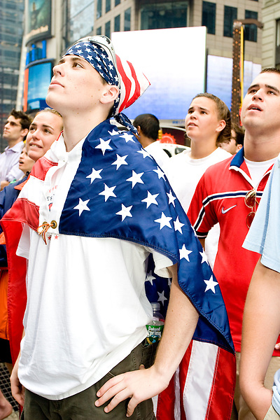 United States fans Tim Wigand and his brother Brien watch their team during a World Cup match against Ghana on June 22, 2006 on a large outdoor Jumbo Tron at Times Square in New York City.<br /> <br /> The World Cup, held every four years in different locales, is the world's pre-eminent sports tournament in the world's most popular sport, soccer (or football, as most of the world calls it).  Qualification for the World Cup is open to any country with a national team accredited by FIFA, world soccer's governing body. The first World Cup, organized by FIFA in response to the popularity of the first Olympic Games' soccer tournaments, was held in 1930 in Uruguay and was participated in by 13 nations.    <br /> <br /> As of 2010 there are 208 such teams.  The final field of the World Cup is narrowed down to 32 national teams in the three years preceding the tournament, with each region of the world allotted a specific number of spots.  <br /> <br /> The World Cup is the most widely regularly watched event in the world, with soccer teams being a source of national pride.  In most nations, the whole country is at a standstill when their team is playing in the tournament, everyone's eyes glued to their televisions or their ears to the radio, to see if their team will prevail.  While the United States in general is a conspicuous exception to the grip of World Cup fever there is one city that is a rather large exception to that rule.  In New York City, the most diverse city in a nation of immigrants, the melting pot that is America is on full display as fans of all nations gather in all possible venues to watch their teams and celebrate where they have come from.