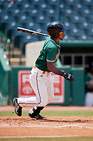 Greensboro Grasshoppers left fielder Jhonny Santos (21) hits a single during a game against the Lakewood BlueClaws on June 10, 2018 at First National Bank Field in Greensboro, North Carolina.  Lakewood defeated Greensboro 2-0.  (Mike Janes/Four Seam Images)
