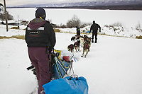 Bob Bundtzen has help parking his team shortly after arriving at Ruby on Saturday morning during Iditarod 2008