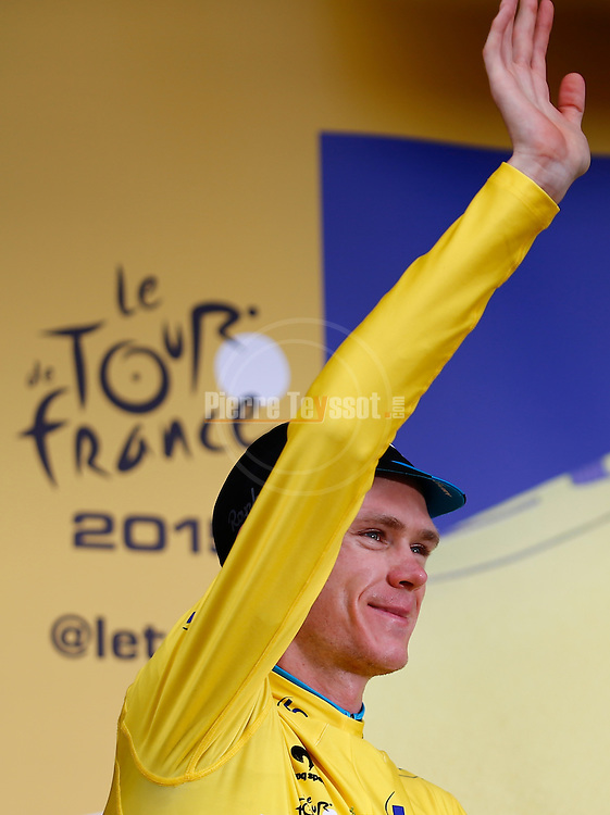 19/07/2015, Valence - Le Tour de France 2015<br /> Christopher Froome at the podium of stage 15 on July 19, 2015 in Valence, France. Christopher Froome (SKY Team) remains leader with the yellow jersey. Germany's Andr&eacute; Greipel wins the stage in a final sprint.<br /> &copy; Pierre Teyssot