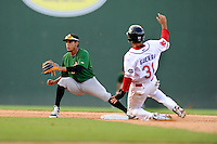 Shortstop JC Rodriguez (6) of the Savannah Sand Gnats, gets the throw too late as Javier Guerra (31) of the Greenville Drive is safe with a stolen base in a game on Sunday, July 5, 2015, at Fluor Field at the West End in Greenville, South Carolina. Savannah won, 8-6. (Tom Priddy/Four Seam Images)