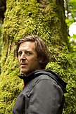 CANADA, Vancouver, British Columbia, Eric Petersen stand in the rainforest on Gambier Island, in the Howe Sound